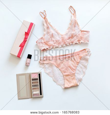 Shopping and fashion concept. Set of glamorous stylish sexy lace lingerie with cosmetic products, woman accessories on white background. Top view point, flat lay.