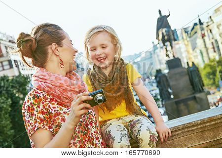Mother And Daughter In Prague Viewing Photos On Camera