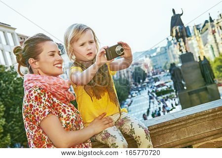 Mother And Daughter Travellers With Camera Taking Photo, Prague