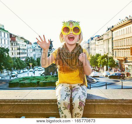 Happy Girl In Prague In Pineapple Sunglasses Handwaving