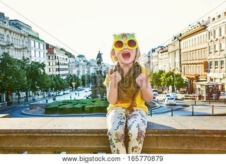 Happy Child In Pineapple Sunglasses Showing Thumbs Up In Prague