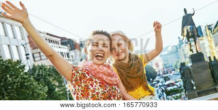 Happy Mother And Daughter Travellers In Prague Rejoicing