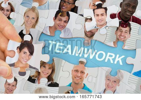 Teamwork Concept With Multicultural Business People Team On Jigsaw Puzzle