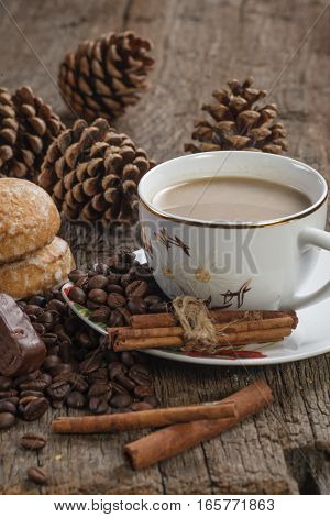 cup of coffee and coffee beans on a old wooden table
