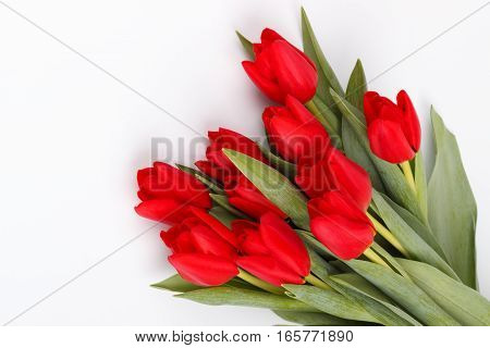 bouquet of red tulips over white background.top view with copy space
