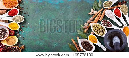 Various Spices On Old Green Background