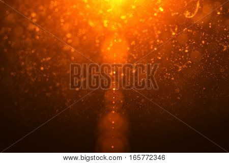 Abstract Golden Light Flare Leaks With Gold Particles