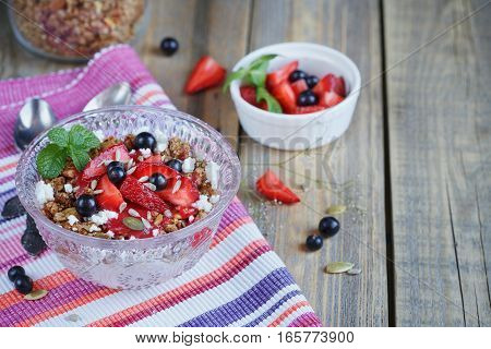 Dessert with fresh berries cottage cheese granola and berries jam. Healthy breakfast.