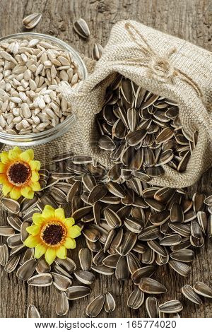 flower seeds in bag on old wooden table