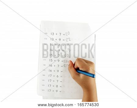 hand of little girl doing maths homework isolated on white background, plus the numbers exercises of primary school children, kids education concept