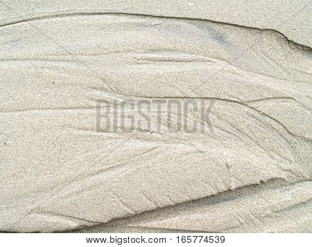 sand texture background, traces of water on the sand