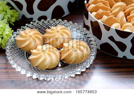 Four Butter Cookies On A Glass Plate