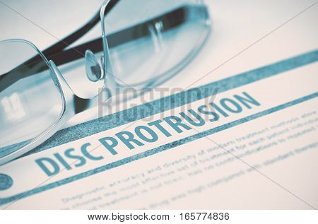 Diagnosis - Disc Protrusion. Medicine Concept with Blurred Text and Glasses on Blue Background. Selective Focus. 3D Rendering.