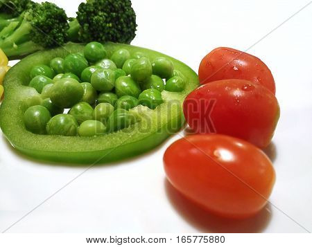 healthy eating food isolated, Grape tomatoes Broccoli Garden Pea Pisum sativum in slice of Bell pepper paprika