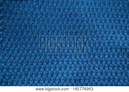 Blue Top Knitted In Manual Photographed In Close-up.