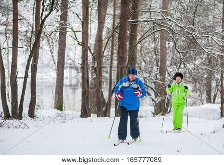 GRODNO BELARUS - JANUARY 15 2017. A senior couple outdoor in a winter setting. The active couple is about to go cross country skiing.