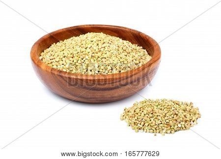 Ecological food.Green buckwheat in a wooden plate isolated on white background.