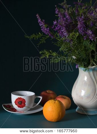 Still life withBlue wild flowers in vase on table