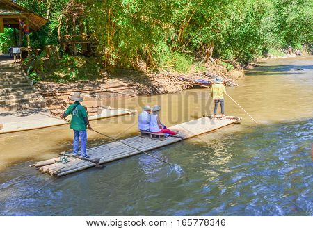 Western Tourists Crossing The Thai River