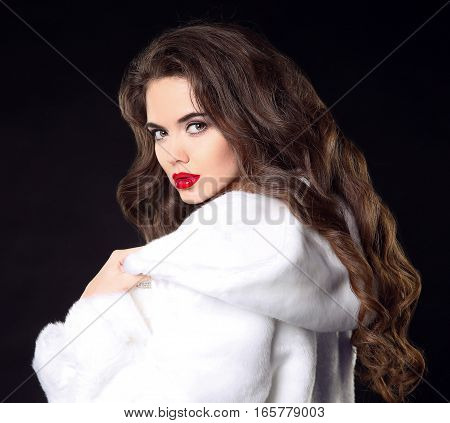 Fashion Portrait Of Beautiful Brunette Girl In White Fur Coat. Attractive Woman Model With Red Lips