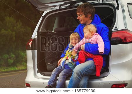 father with two little kids travel by car in nature, family car travel