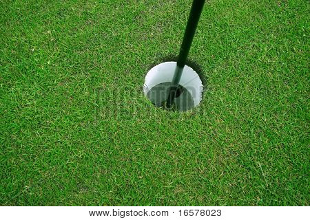 Close-up of a golf hole poster