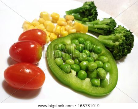 healthy eating food isolated, Grape tomatoes Broccoli Garden Pea Pisum sativum in slice of Bell pepper paprika corn