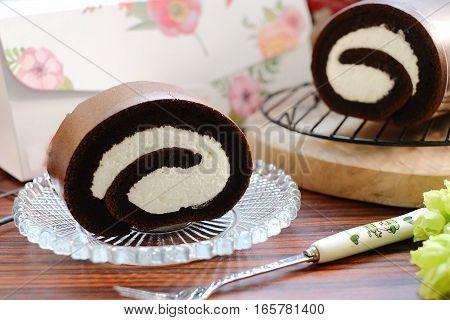 Creamy Chocolate Swiss Roll On Glass Plate