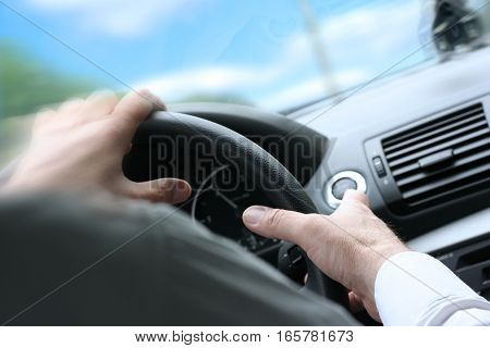 Over Shoulder View Of A Man Driving A Car With His Hands On The Steering Wheel, Turning Quick. Sunny