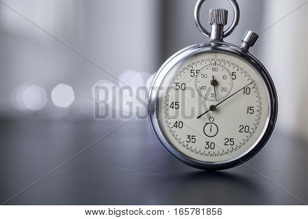 Clock on a blurry background. Stopwatch in work.
