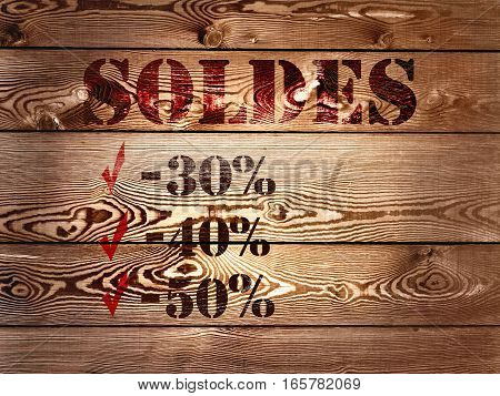 text on wooden panel annoucing sale in french