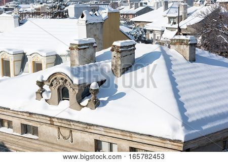 Top view of snow roofs and chimneys.