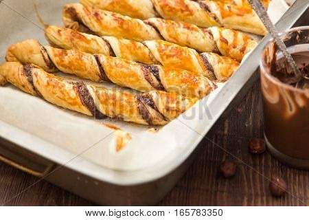 Homemade Cakes - Puff Pastry With Chocolate Paste. Twisted Cakes With Chocolate