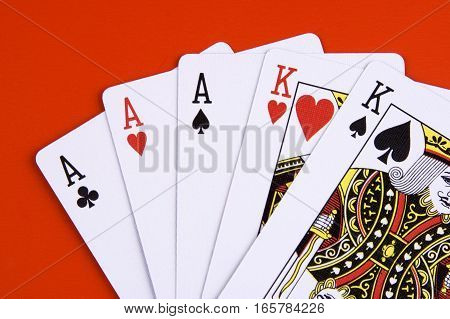 Playing cards top view isolated on red background