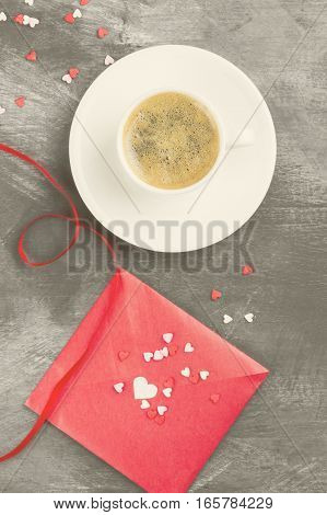 Espresso coffee in a white cup love letter on a dark background. Top view. Food background. Toning.