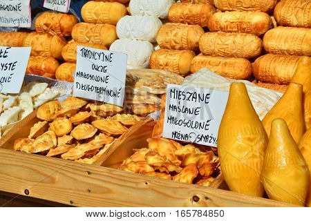 Oscypek cheese - traditional mountain product of Poland Zakopane. Cheese is made of goat cow and sheep milk (on description)