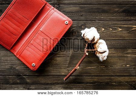Red Wallet of Leather skin on wooden background.
