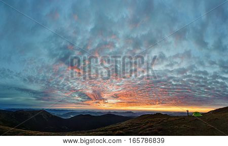 Silhouette Of The Man Taking Picture Of Mountain Landscape