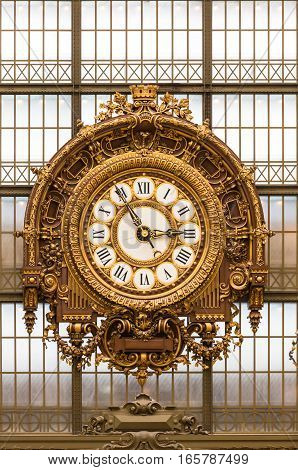 Paris France - August 25 2015: Golden clock of the museum D'Orsay.The Musee d'Orsay is a museum in Paris on the left bank of the Seine. Musee d'Orsay has the largest collection of impressionist and post-impressionist paintings in the world.