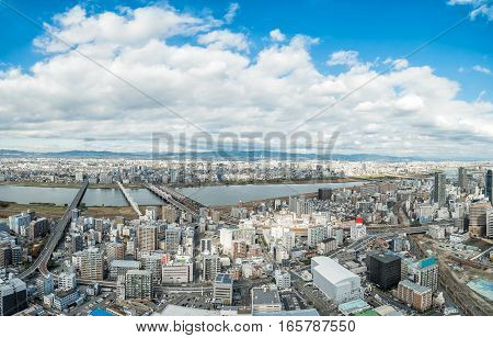 Osaka urban city and Yodo river from rooftop view. Japan.