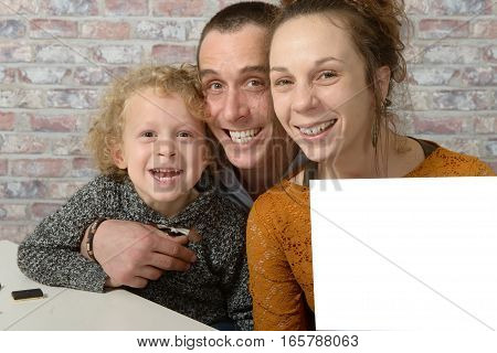 happy family the mom holding a white sheet of paper