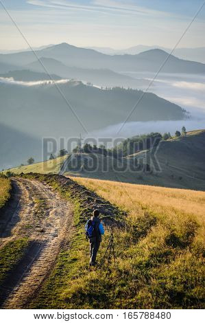 Young Photographer In The Mountains