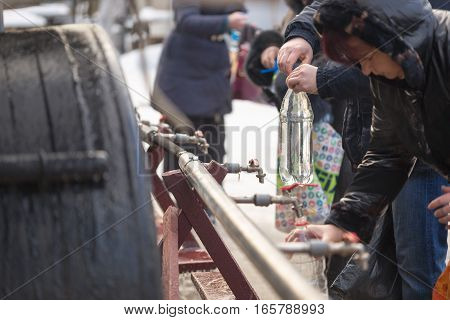 Gomel, Belarus - January 19, 2017: Orthodox People Are Gaining The Holy Water From The Source At The