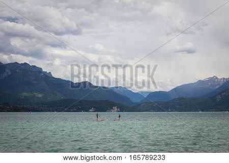 Annecy France - June 15th 2016: Two people practice water boarding on the lake in Annecy France.