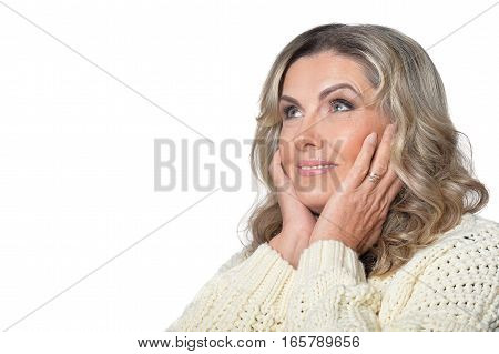 Portrait of smiling mature woman looking at the distance isolated on white background