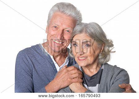 Portrait of smiling senior couple isolated on white background