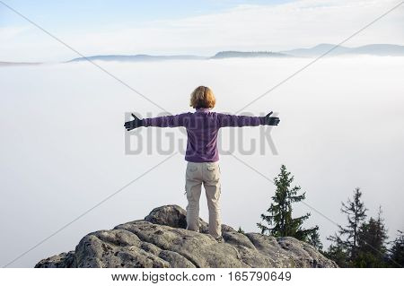 Young Tourist Girl Standing On Top Of Rocks