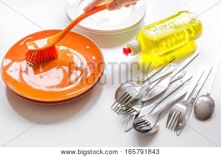 concept of washing dishes on white background close up