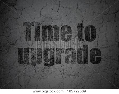Time concept: Black Time To Upgrade on grunge textured concrete wall background