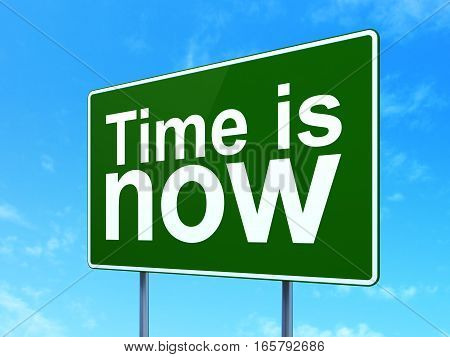 Time concept: Time is Now on green road highway sign, clear blue sky background, 3D rendering